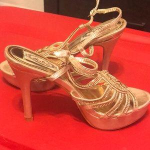 Rhinestone gold shoes.